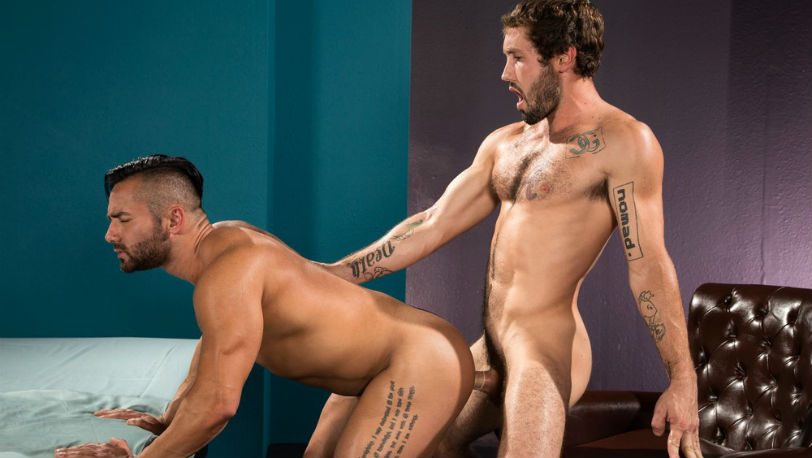 Bruno Bernal swallows Jeff Powers' lengthy, hard cock at Raging Stallion
