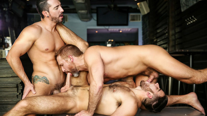 Jimmy Durano, Dirk Caber and Jackson Grant service each other's poles at Men.com