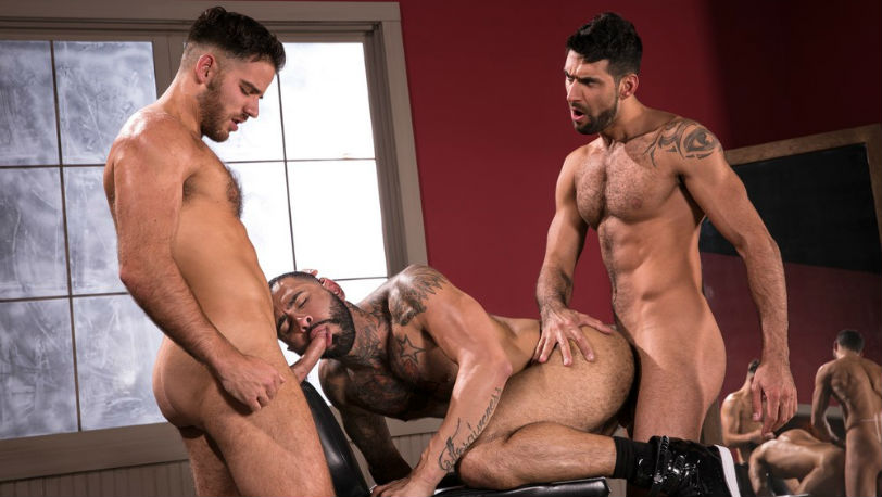 Mick Stakkone makes out with Jackson Grant as Rikk York continues punding at Raging Stallion