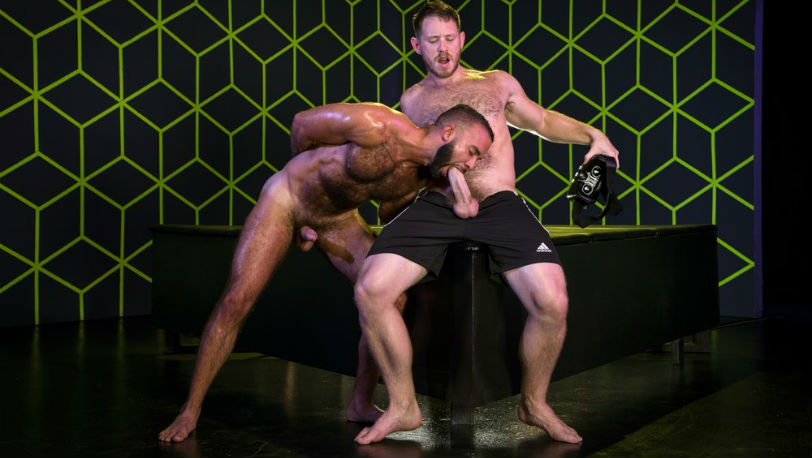 Fernando Del Rio gets on his knees to suck on Spencer Whitman's cock at Raging Stallion