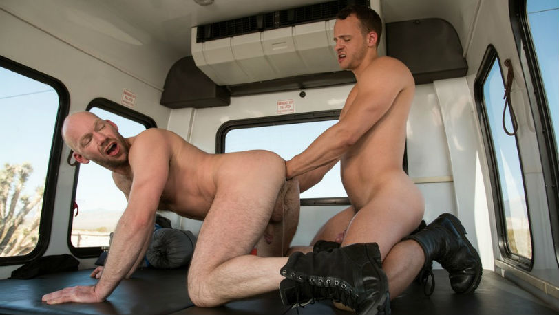 "Mike Tanner lubes up to go wrist deep into Nate Grimes' hole in ""Fist Bus"" from Fisting Central"