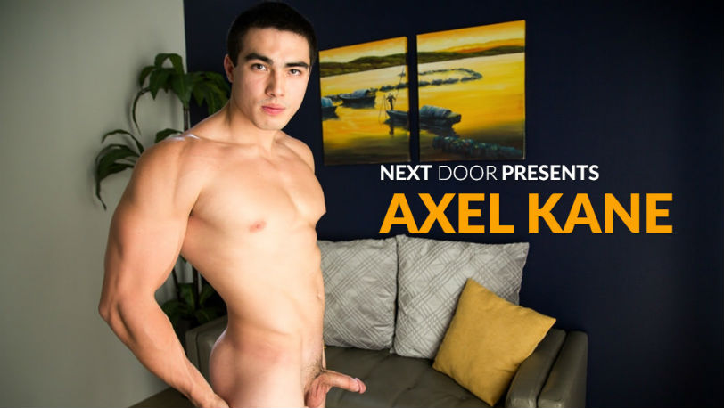 Axel Kane hows off his chiseled physique and his meaty cock at Next Door Studios